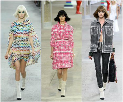 Looks from the Chanel spring/summer 2014 runway collection are presented during Paris Fashion Week.