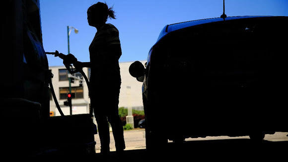 A customer pumps gas at a BP station at Marine Drive and Lawrence Avenue in June.