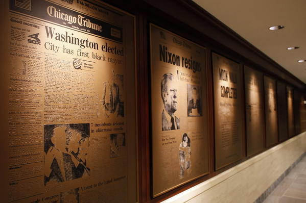 Historic Pages hang in first floor hallway inside the Chicago Tribune Tower.