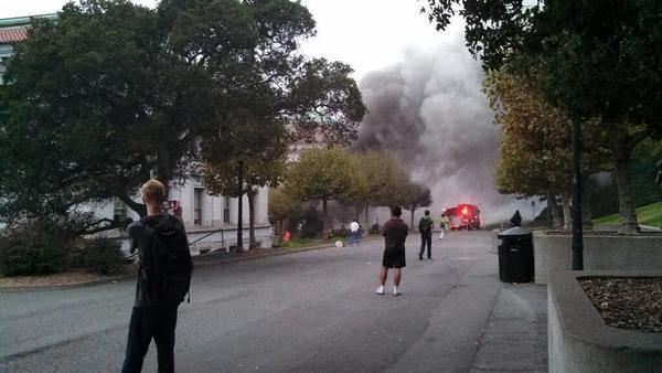 Students stop to look at smoke billowing from an explosion on the UC Berkeley campus Monday. Power was restored to most of the college by early Tuesday.