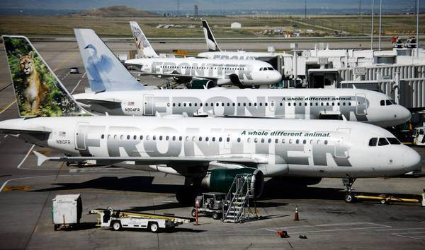 Private equity firm Indigo Partners is reportedly negotiating to buy Frontier Airlines from the Denver carrier's parent company, Republic Airways Holdings Inc. Above, Frontier planes at Denver International Airport.