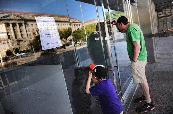 Tourists on Tuesday find the doors to the Museum of American History on the Mall in Washington closed due to the federal government shutdown.