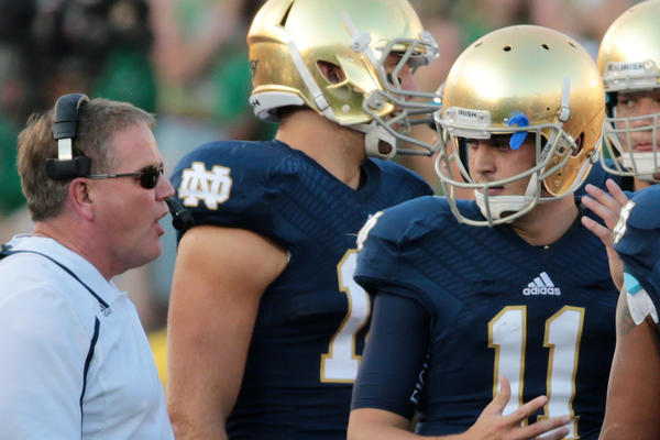 Notre Dame Fighting Irish head coach Brian Kelly talks with quarterback Tommy Rees (11) during the second half Saturdy.