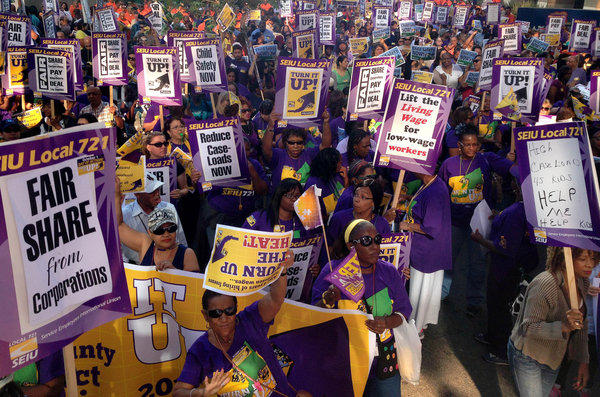 Los Angeles County workers with SEIU Local 721 march for higher wages.
