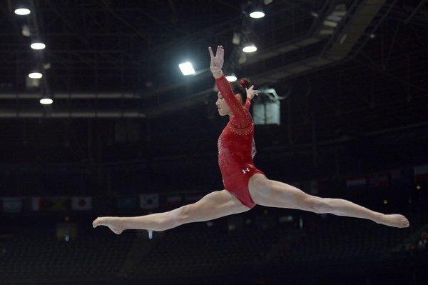 Kyla Ross competes on the balance beam at the 2013 World Championships in Antwerp, Belgium.