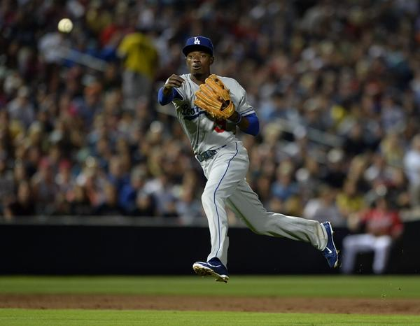 Shortstop Dee Gordon is one of the players working out in center field for the injury-depleted Dodgers.