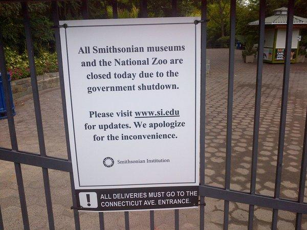 A sign on the locked gates at the National Zoo informs visitors it is closed because of the government shutdown.