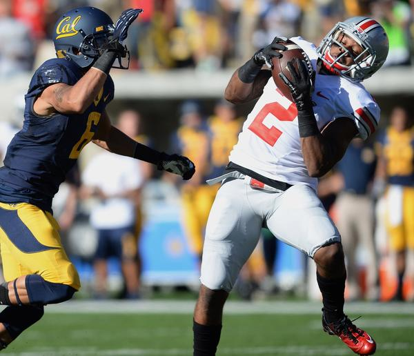 Ohio State's Christian Bryant intercepts a pass intended for Cal's Chris Harper last month.