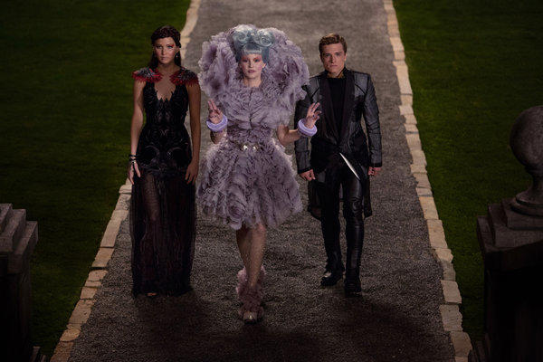 "Jennifer Lawrence, left, is Katniss Everdeen, with Elizabeth Banks as Effie Trinket, and Josh Hutcherson as Peeta Mellark in ""The Hunger Games: Catching Fire."""