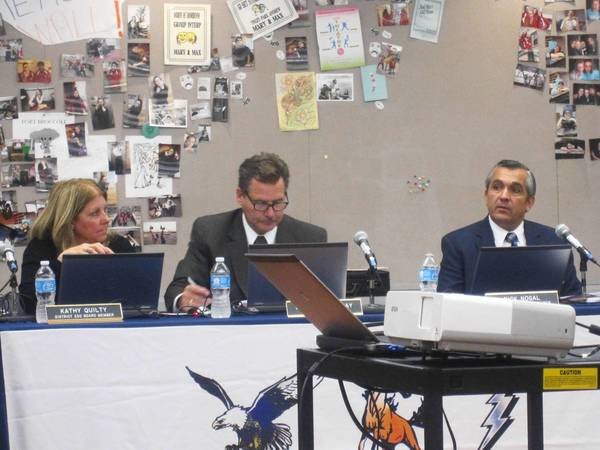 District 230 Superintendent James Gay and School Board President Rick Nogal, right, listen during a public hearing on the district's budget last week