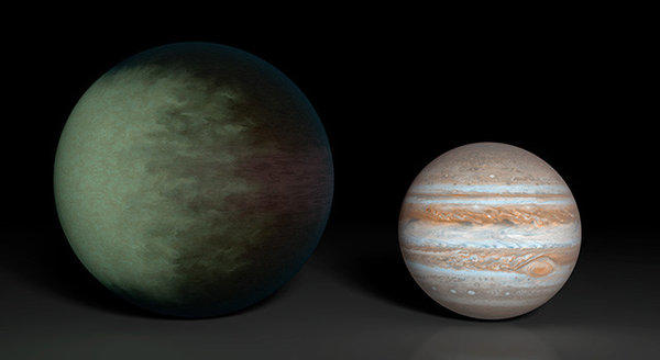 An artist's illustration of Kepler-7b, left, is depicted next to Jupiter. It is 50% larger than Jupiter but 50% less dense, and it is the first exoplanet to have its clouds mapped. The clouds may be greenish and full of silicates, scientists said.