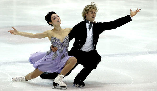 Meryl Davis and Charlie White, shown at the U.S. International Figure Skating Classic on Sept. 13, hope to become the first American couple to win Olympic gold in ice dancing.