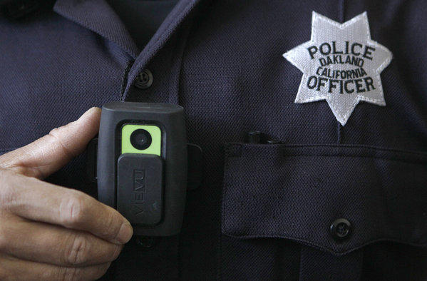 An Oakland police officer shows a video camera worn by some officers in that city. Steve Soboroff, president of the Los Angeles Police Commission, is pushing to outfit LAPD officers with on-body cameras.