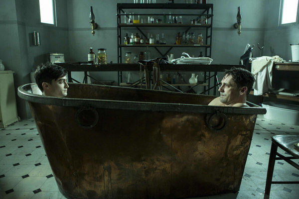"Young doctor (Daniel Radcliffe) shares a tub with his older self (Jon Hamm) in a scene from the Ovation Channel miniseries ""A Young Doctor's Notebook."""