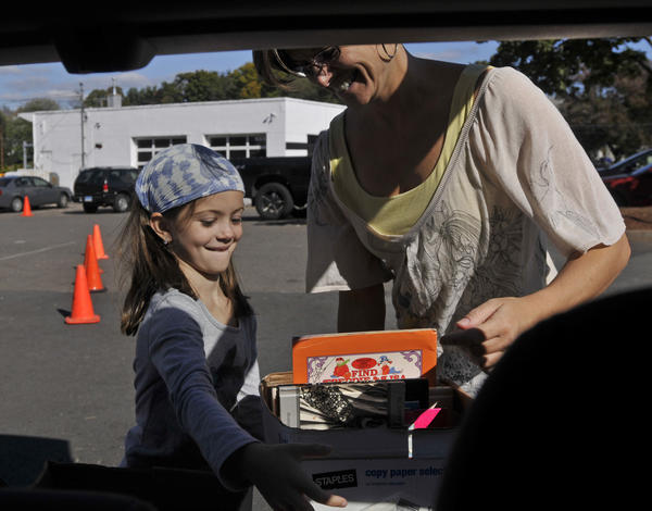 Christie Michaud, right, and daughter McRey Michaud, make a book delivery to Enfield Food Shelf on Sept. 26.