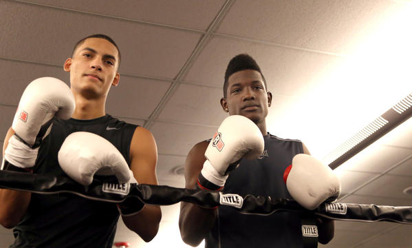 Dennis Galarza, 20, and Erickson Lubin, 18, both from Orlando, pose for photos at Iron Mike Productions Gym in Deerfield Beach. Lubin and Galarza signed as professional boxers with Iron Mike Productions.