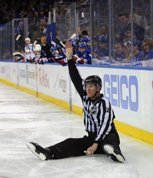 Linesman Jean Morin #97 makes a first period icing call during the game between the New York Rangers and the Washington Capitals in Game Three of the Eastern Conference Quarterfinals during the 2013 NHL Stanley Cup Playoffs at Madison Square Garden on May 6, 2013.
