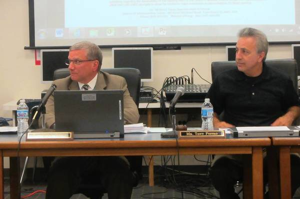 Lake Zurich Community Unit School District 95 Superintendent Mike Egan (left) and board President Tony Pietro listen to a discussion on Egan's state of the schools report. The annual report highlights accomplishments in different district departments over the past year.