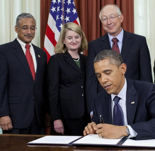 Hampton Mayor Molly Ward, center, is shown in this 2011 photo with Rep. Bobby Scott, D-Va., left and Interior Secretary Ken Salazar, right, as President Barack Obama signs a proclamation to designate Fort Monroe a national monument.