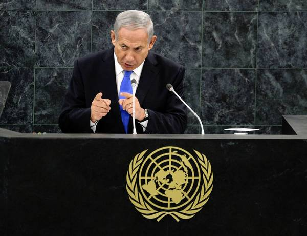 "Israeli Prime Minister Benjamin Netanyahu addresses the U.N. General Assembly in New York. He called Iranian President Hassan Rouhani a ""wolf in sheep's clothing"" and urged the West to maintain sanctions against Iran."