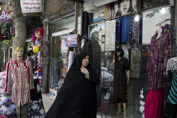 A woman window shops May 28, 2013 in Tehran, Iran. The country's economic problems trace partly to international sanctions imposed because of Iran's nuclear program.