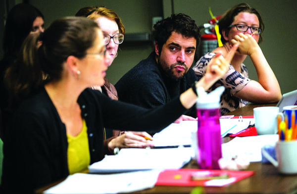 """Director Anne Kauffman (far left) and playwright Noah Haidle (second from right) in rehearsal for """"Smokefall"""" at Goodman Theatre"""