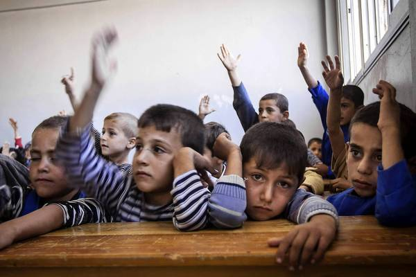 Children attend class in Madaya, Syria. In Damascus, the capital, more than 800 schools opened their doors to about 500,000 students last month, an official said.