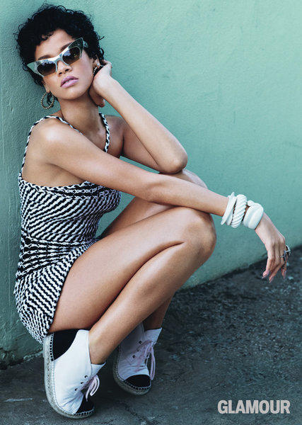 Rihanna wears a Chanel dress and espadrilles, Miu Miu sunglasses and Lynn Ban bracelets in this shot for Glamour.