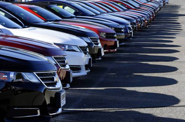 Automakers posted sales of 1.1 million vehicles last month, a 4.2% decrease from September a year ago. Above, Chevrolets are displayed on a dealer's lot in Needham, Mass.