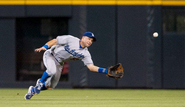Skip Schumaker makes a diving catch against the Colorado Rockies on Sept. 4. Schumaker is likely to start in centerfield when the Dodgers open their National League Division Series against the Atlanta Braves on Thursday.
