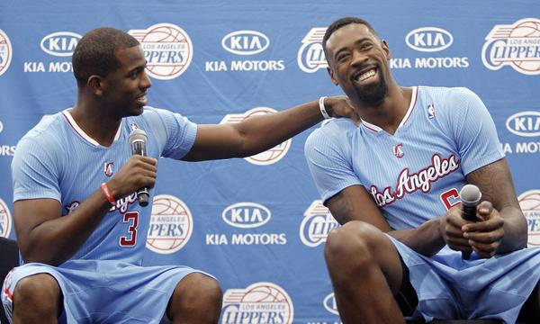 Clippers point guard Chris Paul, left, shares a light-hearted moment with center DeAndre Jordan during Clippers media day on Monday. Jordan was all business at training camp Tuesday.