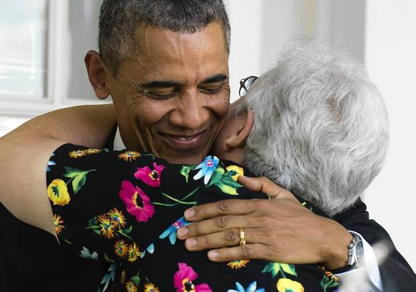 President Obama hugs a woman who will benefit from health insurance plans under the Affordable Care Act after speaking about healthcare reform at the White House on Tuesday.