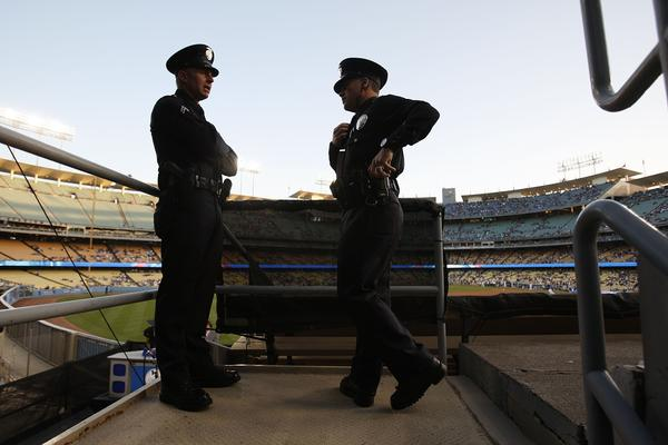 Los Angeles Police officers at Dodger Stadium in 2011. A gift from the team boosts a plan to equip LAPD patrols with on-body cameras.