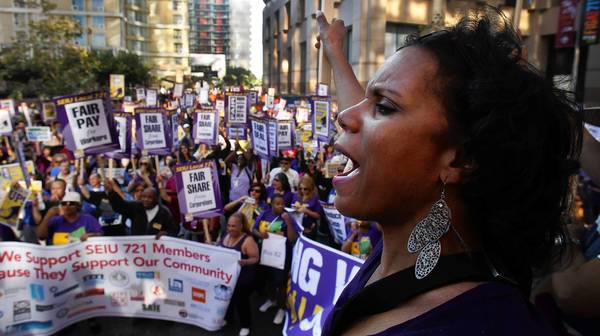 Thousands of Service Employees International Union members rally during a march at the California Plaza in downtown Los Angeles on their way to the Kenneth Hahn Hall of Administration. They were demanding a better contract offer from L.A. County.