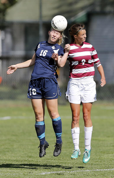 Sarah Pieper (16) of Concordia-St. Paul and Anna Bondy (9) of Northern State use their heads to try to advance the ball during a recent soccer match.