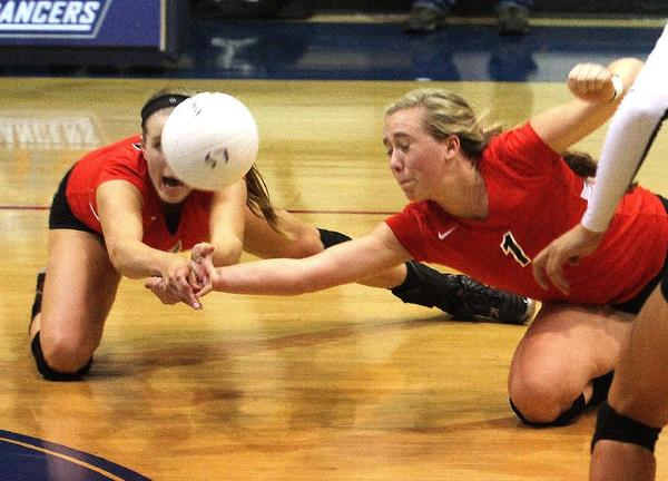 Flintridge Sacred Heart Academy's Katie Conley and Sophia Coffey dive for a ball in a four-game loss to La Salle.