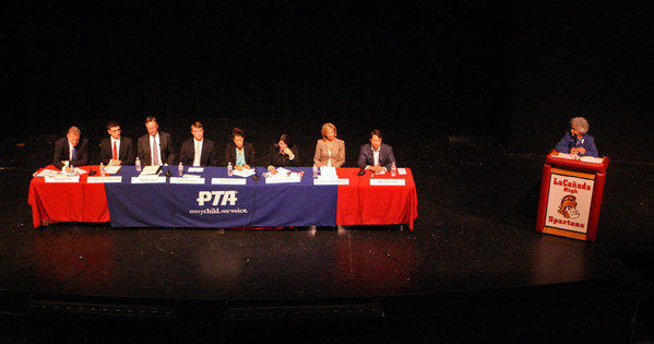 Candidates, from left, Dan Jeffries, Kevork Kurdoghlian, David Sagal, Ian Mirisola, Karyn Riel, Kaitzer Puglia, Jennifer Rubendall, and Joel Peterson at a candidates forum for the La Cañada Unified School District board at La Cañada High School on Tuesday, Oct. 1, 2013. There are 8 candidates running for three open seats.