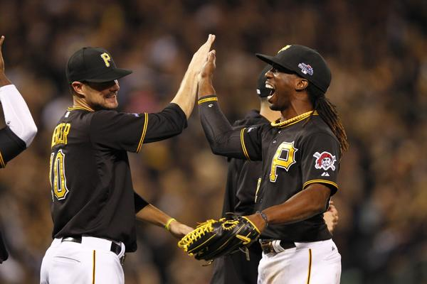 Jordy Mercer and Andrew McCutchen celebrate after the Pittsburgh Pirates' 6-2 victory over Cincinnati in the National League wild card game Tuesday night.