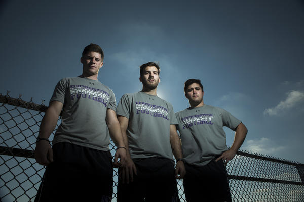 Northwestern football players Jeff Budzien (from left), Brandon Williams and Patrick Hickey are the keys to the Wildcats' kicking success.