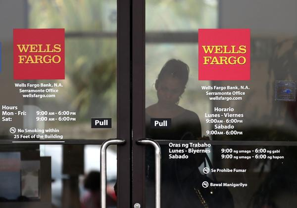 Wells Fargo faces a legal action filed by New York Atty. Gen. Eric Schneiderman, who claims the bank failed to live up to the terms of the landmark $25-billion national mortgage settlement.
