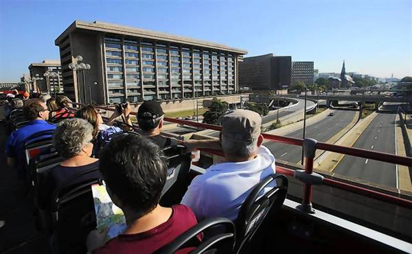 Tourists visiting Washington cross over a lightly traveled Southwest-Southeast Freeway atop a double-decker tour bus on the second day of the shutdown.