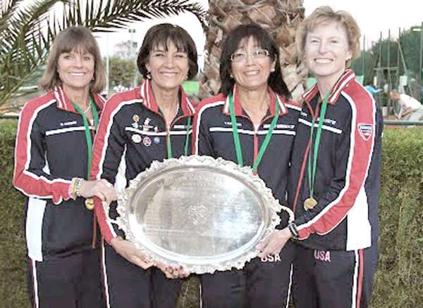 Tina Karwasky of Glendale, third from the right, poses with Diane Barker, Susan Wright and Pat Purcell. Karwasky helped the United States win the Maureen Connolly Cup in Turkey. (Courtesy of the International Tennis federation)