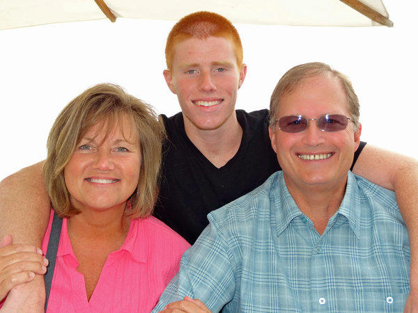June 2013 photo of Bryce Laspisa with his parents, Karen and Michael.