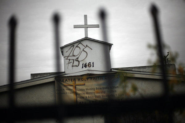 Graffiti mars the steeple on the Greater Holy Faith Baptist Church on 155th Street in Compton in January. Cases of vandalism make up close to one-third of reported hate crimes, according to a new report.