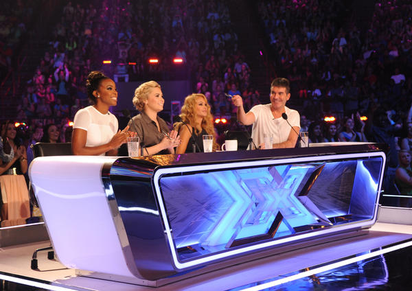 "Kelly Rowland, left, Demi Lovato, Paulina Rubio and Simon Cowell on the set of ""The X Factor"" in New Orleans."
