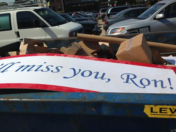 A Ron Santo sign lies in a dumpster on the day after the 2013 season ended.