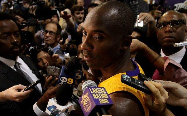 Kobe Bryant, shown at the Lakers' media day Saturday in El Segundo, is recovering from a torn Achilles' tendon.