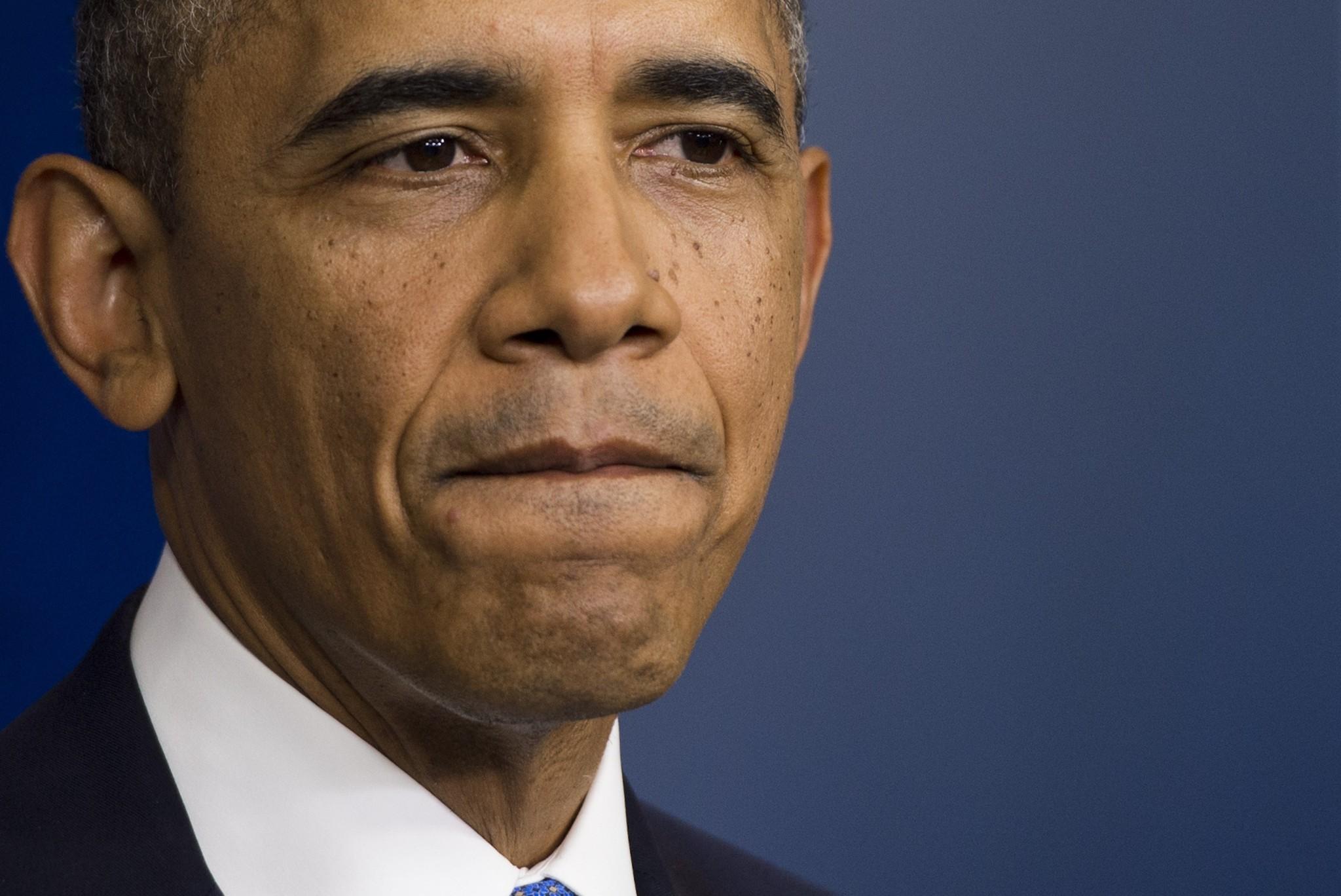 Government Shutdown Obama Obama adopts arm's-len...