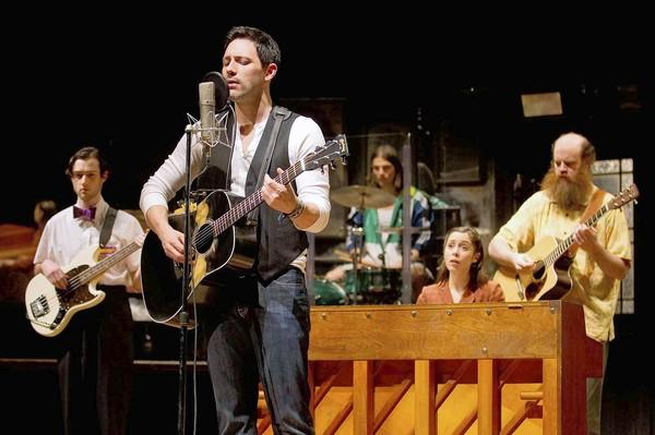 "The Broadway company of ""Once"" was led by Steve Kazee, second from left. The tour hits Chicago on Wednesday."
