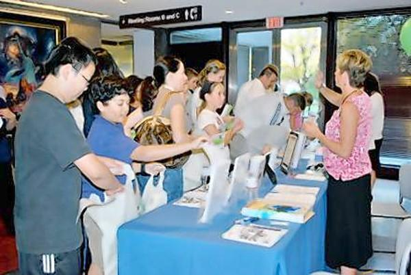 Families signing-up for previous volunteer fairs.